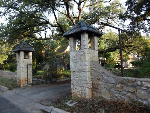 Pillar entrance looks newer than the fence.